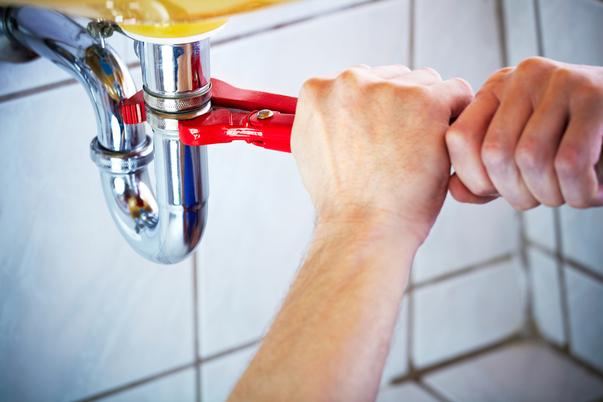 A man fixing bathroom pipe